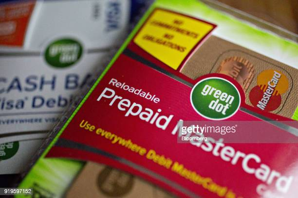 Packages containing a Green Dot Corp prepaid Mastercard Inc debit card and Visa Inc debit card left are arranged for a photograph in Washington DC US...