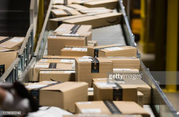Packages for distribution sit on a conveyor belt at an Amazon.com Inc. Fulfillment center in Kegworth, U.K., on Monday, Oct. 12, 2020. Prime Day, a...