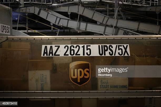 Packages line the inside of a United Parcel Service Inc shipping container during the afternoon sort at the UPS Worldport hub in Louisville Kentucky...