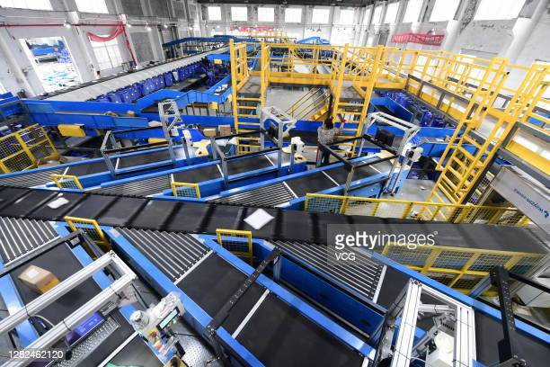 Packages move along a conveyor belt at an automatic parcel sorting warehouse of a express company on October 27, 2020 in Taicang, Jiangsu Province of...