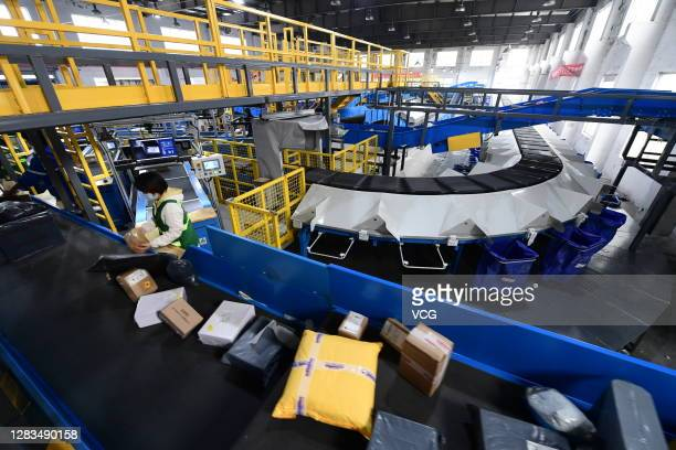 Packages move along a conveyor belt at an automatic parcel sorting warehouse of a express company during 2020 Double 11 Shopping Festival on November...