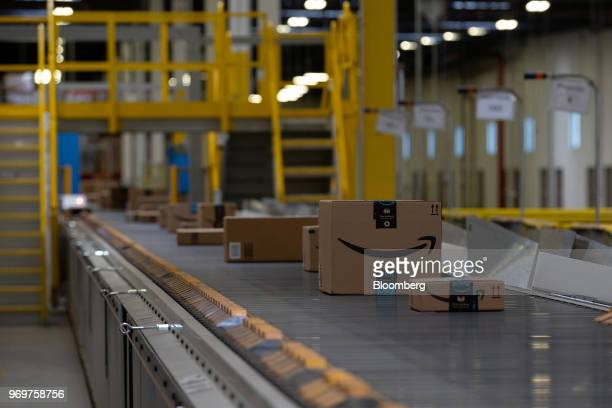 Packages move along a conveyor belt at the Amazoncom Inc fulfillment center in Robbinsville New Jersey US on Thursday June 7 2018 Seattlebased Amazon...