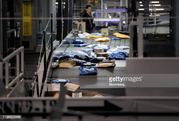 Packages move along a conveyor belt at the United Parcel Service Inc Utah Regional Hub in Salt Lake City Utah US on Monday March 11 2019 UPS is...