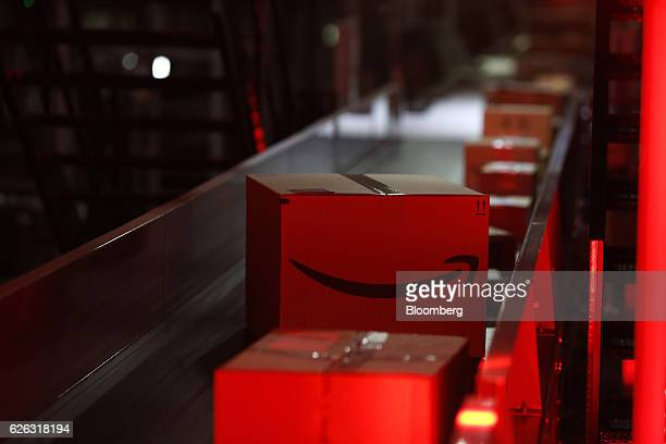 Packages move along a conveyor belt at the United Parcel Service Inc Chicago Area Consolidation Hub facility in Hodgkins Illinois US on Monday Nov 28...