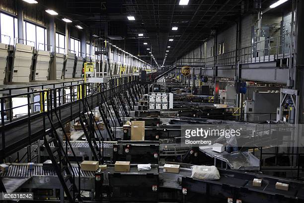 Packages move along conveyor belts while being sorted at the United Parcel Service Inc Chicago Area Consolidation Hub facility in Hodgkins Illinois...