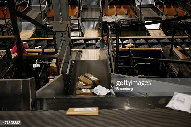 Packages move down conveyor belts during the afternoon sort at the United Parcel Service Inc Worldport facility in Louisville Kentucky US on Tuesday...