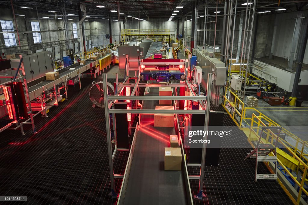 Packages move through an automated scanner at the FedEx Corp. Ground distribution center in Jersey City, New Jersey, U.S., on Tuesday, Aug. 7, 2018. FedEx is heading into fiscal 2019 running on all cylinders, with revenue growth and margin expansion expected across all three of its segments. Photographer: Marc McAndrews/Bloomberg via Getty Images