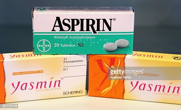 Packages of Bayer aspirin and Schering Yasmin contraceptive pills lie on a table at a pharmacy on March 24 2006 in Berlin Germany Schering announced...