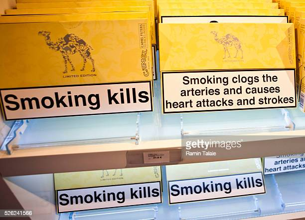 Packages of Camel brand cigarettes with antismoking and health warnings are displayed at a shop in Istanbul Turkey on January 1 2010