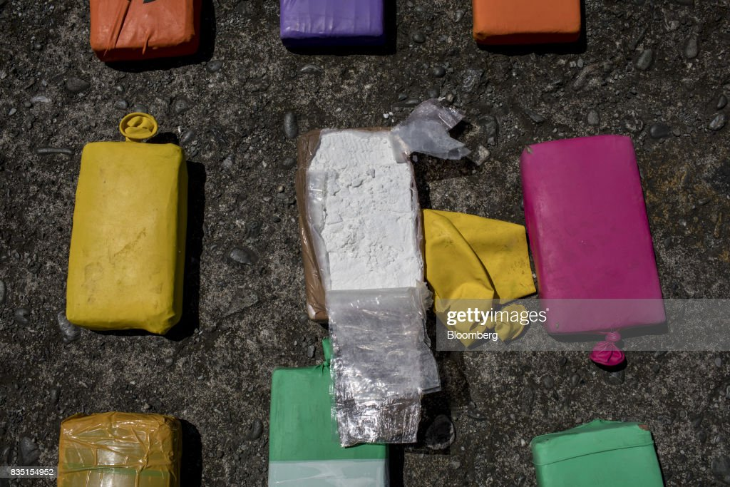 Packages of cocaine, seized inside a shipping container at the Buenaventura port, is seen following an anti-narcotics police raid in Buenaventura, Colombia, on Thursday, Aug. 10, 2017. The United Nations Office of Drugs and Crime (UNODC) released a report stating that coca crops in Colombia has increased over fifty percent in one year. The Trump administration has been putting pressure on Colombia to curb the flow of drugs into the U.S. Photographer: Nicolo Filippo Rosso/Bloomberg via Getty Images