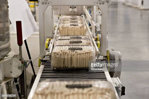 Packages of Depend adult diapers move along a conveyor belt during production at the KimberlyClark Corp Neenah Cold Spring facility in Neenah...