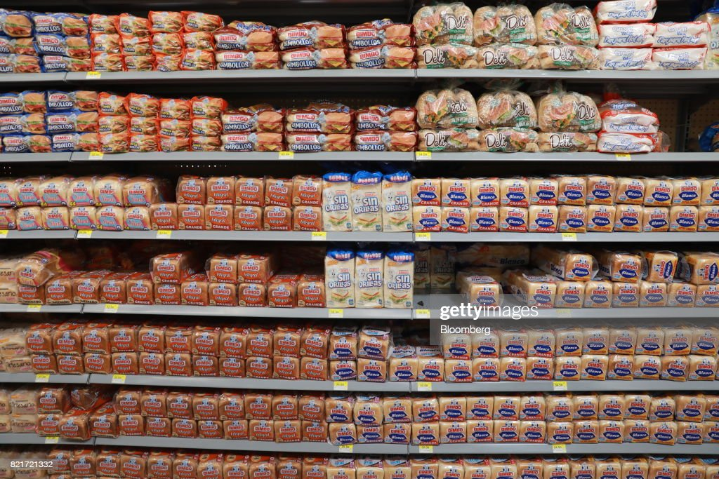 Packages of Grupo Bimbo SAB brand bread sit on display for sale at a