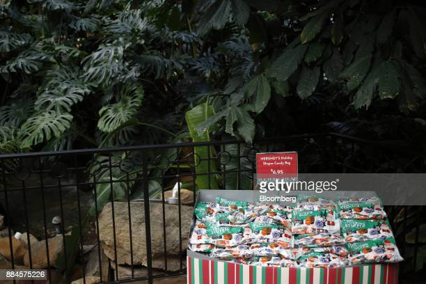 Packages of Hershey Co holiday candy are displayed for sale inside of the company's Chocolate World visitor center in Hershey Pennsylvania US on...