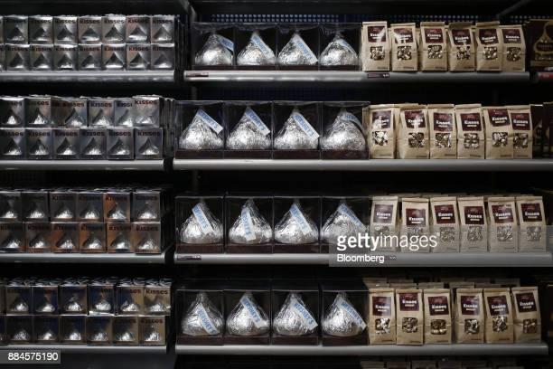Packages of Hershey Co Kisses candies are displayed for sale inside of the company's Chocolate World visitor center in Hershey Pennsylvania US on...