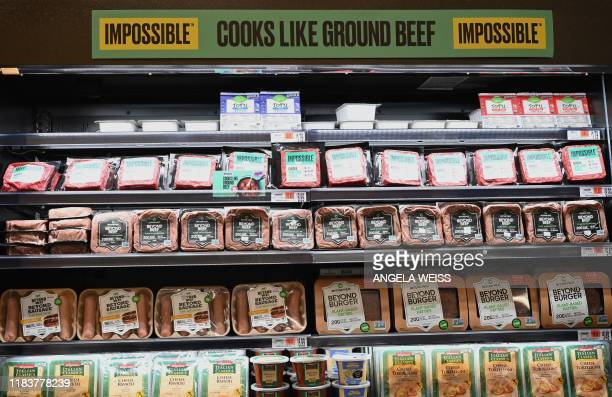 Packages of Impossible Foods burgers and Beyond Meat made from plantbased substitutes for meat products sit on a shelf for sale on November 15 2019...