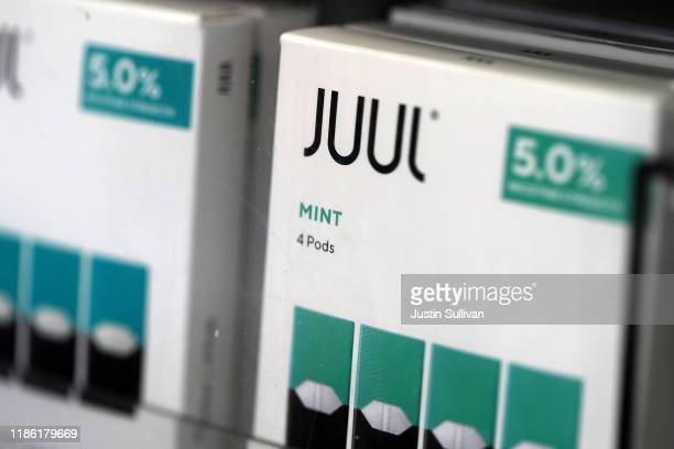 Packages of Juul mint flavored ecigarettes are displayed at San Rafael Smokeshop on November 07 2019 in San Rafael California Juul a leading...