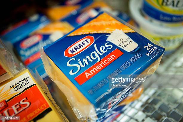 Packages of Kraft Foods Group Inc Singles cheese slices are displayed for sale at a supermarket in New York US on Monday Nov 5 2012 Kraft Foods Group...