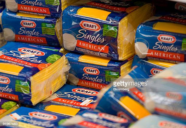 Packages of Kraft Foods Inc American cheese sit on display at a grocery store in New York US on Wednesday Sept 9 2009 Kraft the world's secondlargest...