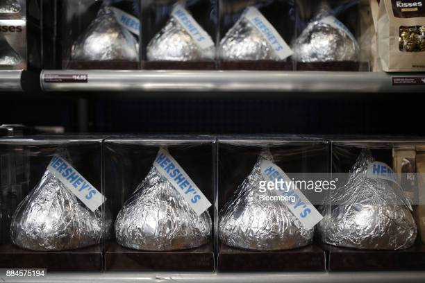 Packages of large Hershey Co Kisses candies are displayed for sale inside of the company's Chocolate World visitor center in Hershey Pennsylvania US...