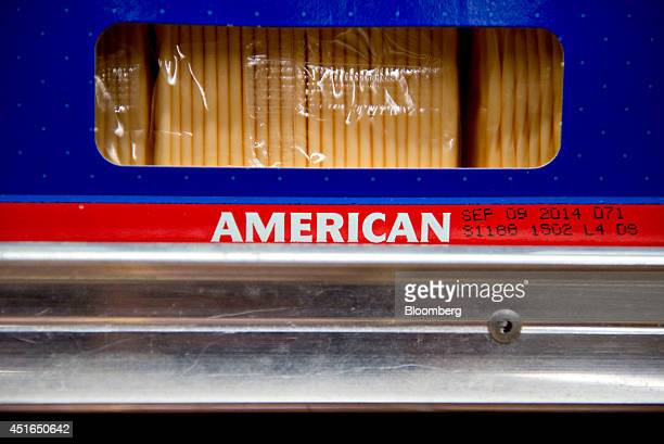 Packages of sliced American cheese sit on display for sale in a supermarket in Princeton Illinois US on Wednesday July 2 2014 Rising prices for beef...