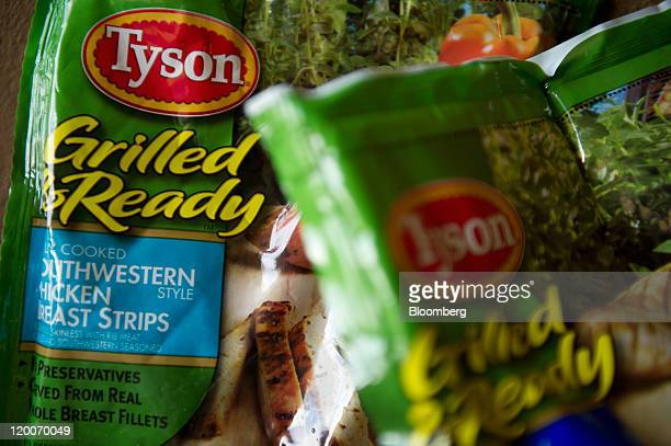 Packages of Tyson Foods Inc chicken breast strips are arranged for a photograph in San Francisco California US on Friday July 29 2011 The US chicken...