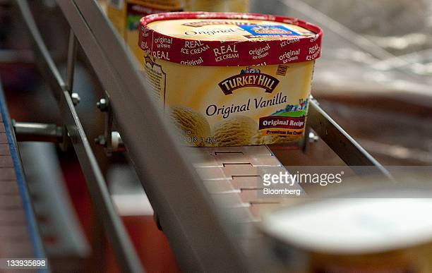 Packages of vanilla ice cream move along a conveyer belt at Turkey Hill LP's production facility in Contestoga Pennsylvania US on Monday Nov 21 2011...
