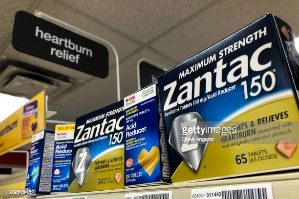 Packages of Zantac a popular medication which decreases stomach acid production and prevents heartburn sit on a shelf at a drugstore on September 19...