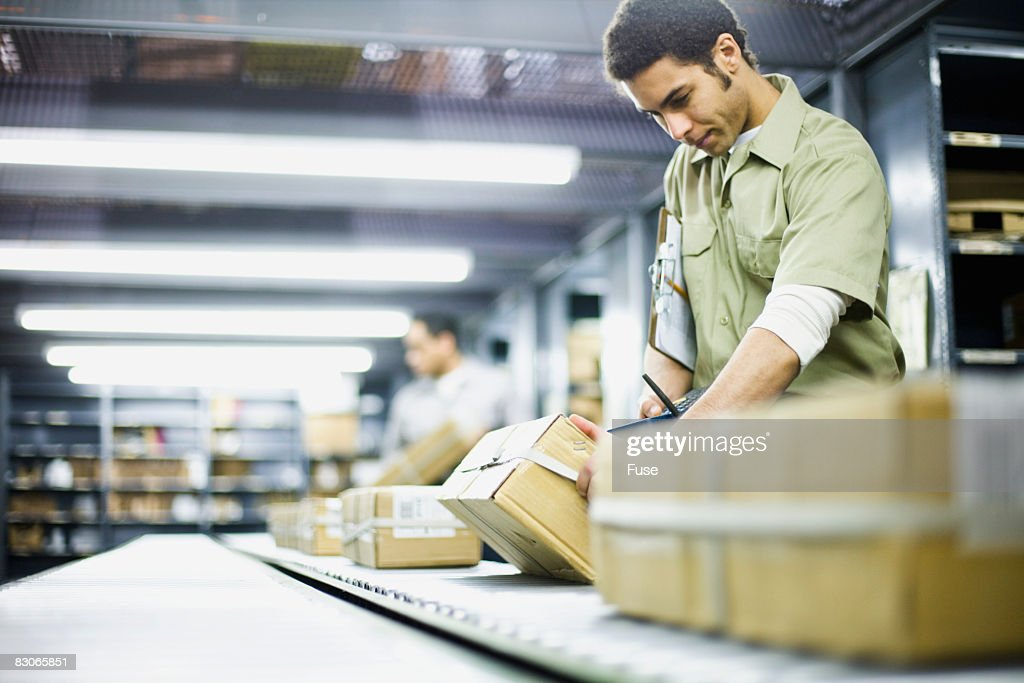 Packages on Conveyor Belt : Stock Photo