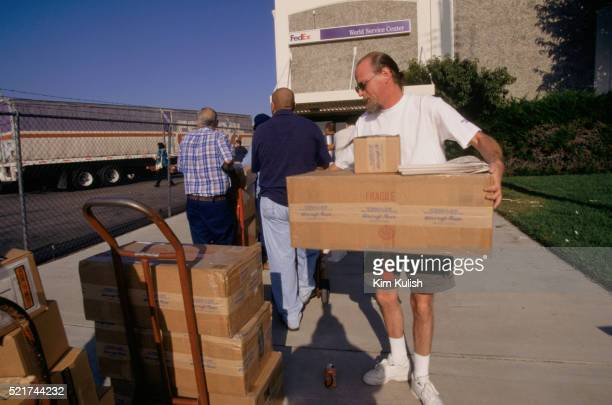 packages outside federal express service center - federal express stock pictures, royalty-free photos & images