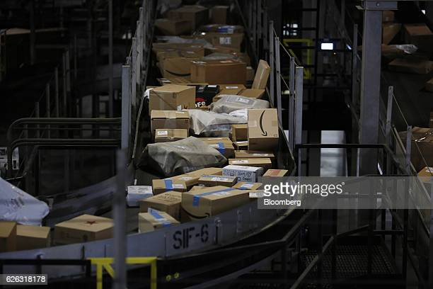 Packages shipped from Amazoncom move along a conveyor belt at the United Parcel Service Inc Chicago Area Consolidation Hub facility in Hodgkins...