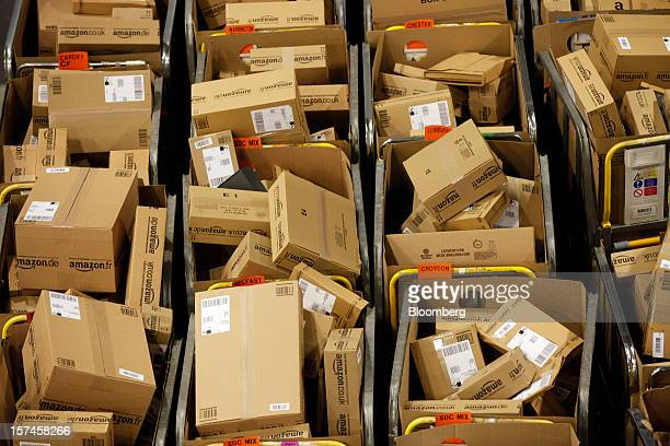 Packages sit in regional delivery dividers ahead of distribution at the Amazoncouk Marston Gate 'Fulfillment Center' the UK site of Amazoncom Inc in...