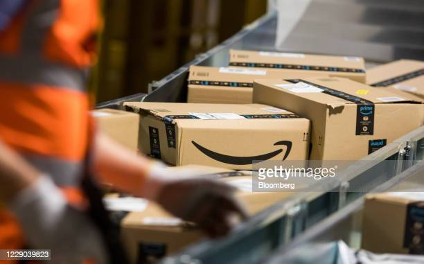 Packages sit on a conveyor belt at an Amazon.com Inc. Fulfilment center in Kegworth, U.K., on Monday, Oct. 12, 2020. Prime Day, a two-day shopping...