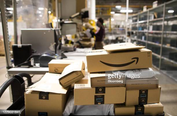 Packages sit stacked at an Amazon.com Inc. Fulfillment center in Kegworth, U.K., on Monday, Oct. 12, 2020. Prime Day, a two-day shopping event Amazon...