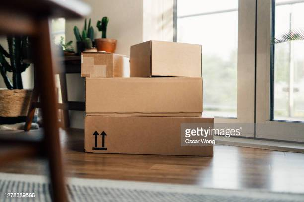 packages waiting on the doorstep - gift stock pictures, royalty-free photos & images