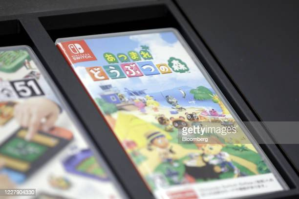 Packaging case for Nintendo Co.'s video game Animal Crossing: New Horizons for the Switch console sits on display inside the Nintendo TOKYO store in...