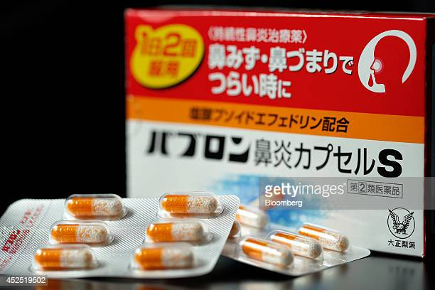 Packaging for and capsules of Taisho Pharmaceutical Co's Pabron Rhinitis Capsule S are arranged for a photograph in Tokyo Japan on Monday July 21...