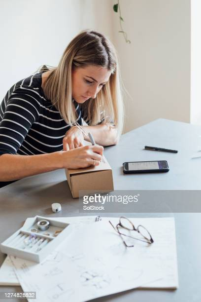 packaging her products - femalefocuscollection stock pictures, royalty-free photos & images
