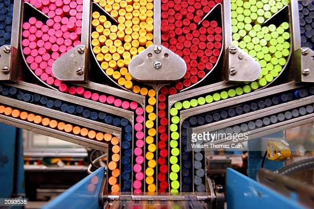 A packaging machine sorts crayons while moving them toward individual boxes at Binney and Smith Inc the manufacturer of Crayola crayons June 18 2003...