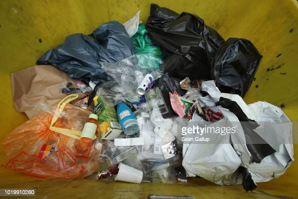 Clear glass bottles and jars lie in a recycling bin on August 20 2018 in Berlin Germany According to data for 2016 recently released by Germany's...