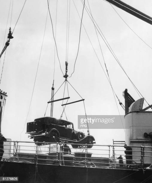 Packard car being hoisted onto a ship, circa 1935.