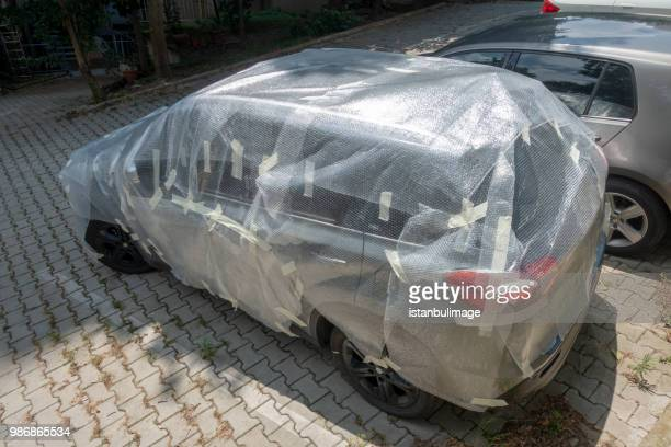 packed car to protect from hail rain in istanbul - hail damage car stock pictures, royalty-free photos & images