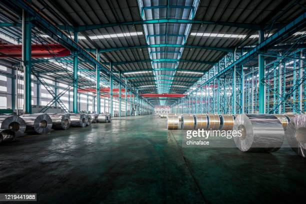 packed coils of steel sheet - making stock pictures, royalty-free photos & images