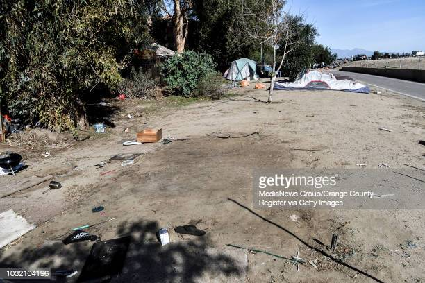 Packed down dirt marks the spot where a tent was recently removed from the Santa Ana river homeless encampment in Anaheim on Monday Jan 29 2018