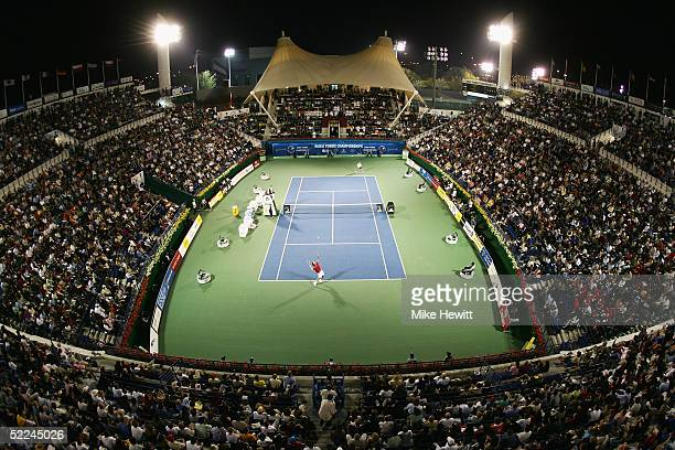 A packed house watches Roger Federer of Switzerland and Andre Agassi of USA in their semifinal match at the Dubai Duty Free Men's Open Tennis...