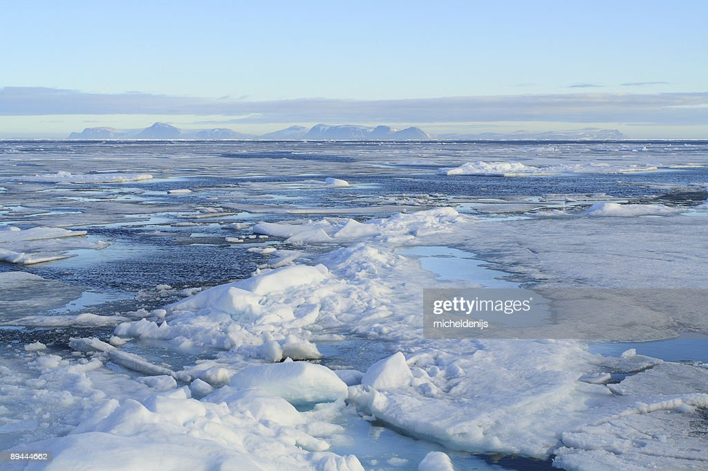 Packed ice tundra melts in the sun : Stock Photo