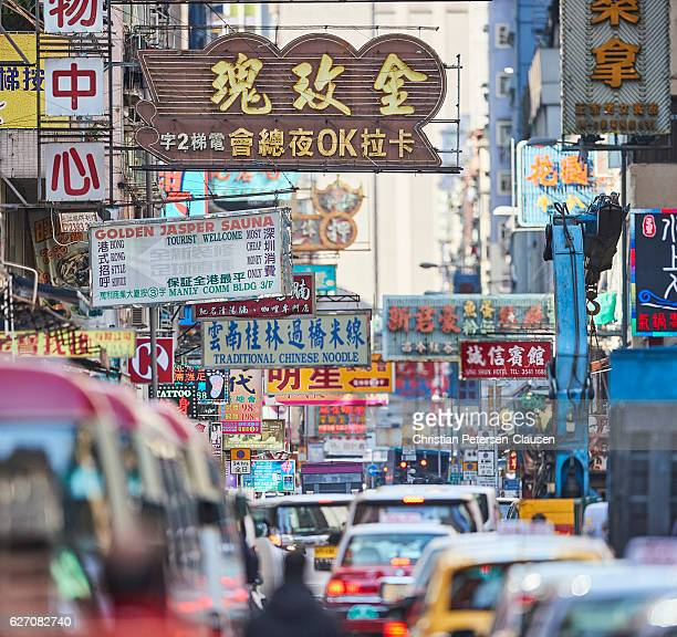Packed Kowloon street with many signs