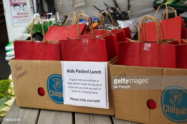 Packed lunches containing sandwiches, fruit and other goods are offered for free at the local post office on October 26, 2020 in Brompton-On-Swale,...