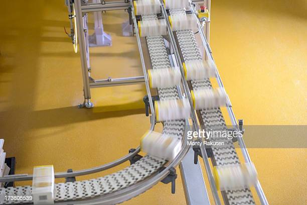 packed products on conveyor belt in biscuit factory - conveyor belt stock pictures, royalty-free photos & images