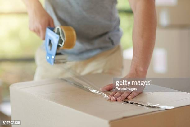 packed safe and snug - tape dispenser stock photos and pictures