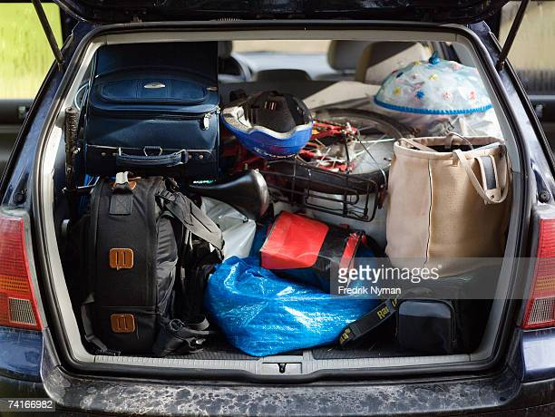 A packed trunk on a car.